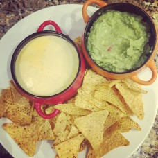 Nachos with cheese sauce and guacamole sauce